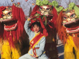 Girl Playing Lion Dance for Chinese New Year  Beijing  China