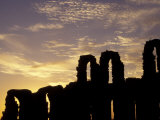Silhouetted Ruins of a Roman Amphitheatre at Sunset  Tunisia