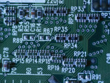 Close View of Computer Circuitry Board Connections Soldered Together