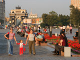 People in Victory Park with Triumphal Arch in Distance  Moscow  Russia