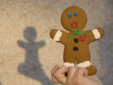 A Gingerbread Cookie Looks Scared While Being Held in a Boy's Hand