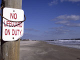 """An Ironic Sign Warns """"No Lifeguard"""" on a Totally Empty Beach"""