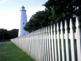 The Lighthouse Stands Behind a Fence on Ocracoke Island