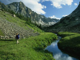 Hiker along a Stream in a Beartooth Mountains Valley