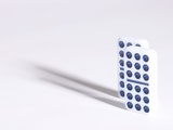 Line of Two Black and White Dominoes Against White Background
