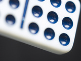 Black and White Domino Against Black Background