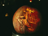 Jack-O-Lantern with an Ornate Carved Decoration of a Witch