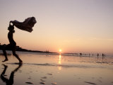 Silhouetted Girl Runs with Beach Towel  MA