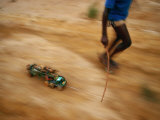 Child Pulling his Toy Truck at High Speed