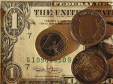 Euro Coins on Top of an American Dollar Bill