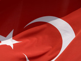 Close-up of the Flag of Turkey with a White Star and Moon on Red Fabric