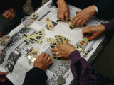 Locals Play a Chinese Card Game on a Newspaper in a Wuhan Park