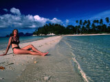 Woman Sunbathing on Sand Spit of Snick Island  El Nido  Philippines