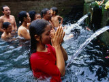 People Praying at Holy Water Ceremony  Spring Water Temple  Tampaksiring  Ubud  Indonesia
