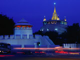 Illuminated Golden Mount at Wat Saket and Democracy Monument Bangkok  Thailand