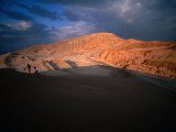 Couple of Hikers Walking Through Shadows at Dusk  Valle De La Luna  Chile