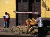 Street Vendor with Bicycle Cart Laden with Fruit and Vegetables  Mexico