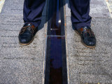 Feet Standing on the East/West Meridian Line at the Royal Observatory  Greenwich  London  Uk