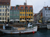Boats in Canal by Buildings  Copenhagen  Denmark