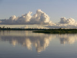 A Puffy Cloud over a Calm Waterway