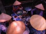 Women in Traditional Conical Hats Sitting Down to Meal at Market  Hoi An  Vietnam
