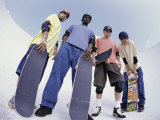 Low Angle View of a Group of Young Men Holding Skateboards