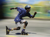 Teen Boy Rollerblading Quickly