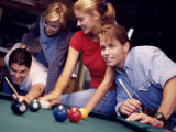Two Young Couples Playing Pool