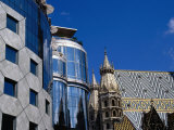 "Gothic Stephansdom (St Stephen's Cathedral) and Hans Hollein's ""Haas Haus "" Vienna  Austria"