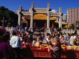 Crowds of People Giving Offerings in Grounds of Wong Tai Sin Temple  Kowloon  Hong Kong