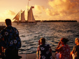 People Looking at Harbour from Mallory Square at Sunset  Key West  USA