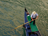 A Gondolier Steers His Craft Through a Canal  Venice  Veneto  Italy