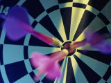 Close-up of Three Darts in the Bull's-Eye of a Dartboard