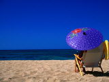 A Girl on the Beach Shading Under a Colourful Umbrella  Waikiki  Oahu  Hawaii  USA