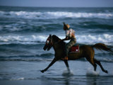 Boy Riding Pony on Beach Parangtritis  Central Java  Indonesia
