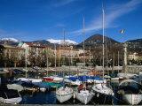 Yachts in Harbour at Intra with Old Town and Mountains in Background  Lago Maggiore  Italy