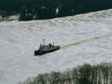 A US Coast Guard Boat Breaks its Way Through the Icy River
