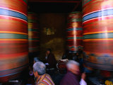 Pilgrims Turning Giant Prayer Wheels in the National Chorten of Thimphu  Thimphu  Bhutan