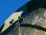 A Rock Climber Scales the Flat Rock Surface of a Cliff Near Needles  California
