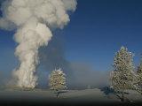 Winter View of Old Faithful Geyser Erupting