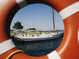 An Orange Life Preserver Frames a Sailboat at the Museum