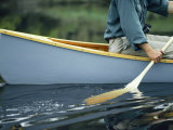 Close View of a Person Paddling a Canoe