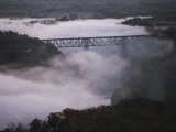 A Railroad Bridge Crosses a Fog-Bound River