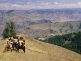 A Group of Horseback-Riding Tourists Take in the View of Hells Canyon
