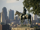 The Scout  a Statue of a Native American and a Horse  Overlooks a City