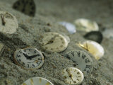 Old Watch Faces in Sand