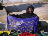 A Nubian Woman Sells Colorful Scarves on the Street