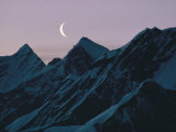 Moonrise over Snowy Mountains