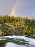 The Mist-Filled Tides of Clearwater River Wash against a Rocky Shore Where a Ra Inbow Takes Form