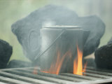 Coffee Pot Steaming over a Campfire